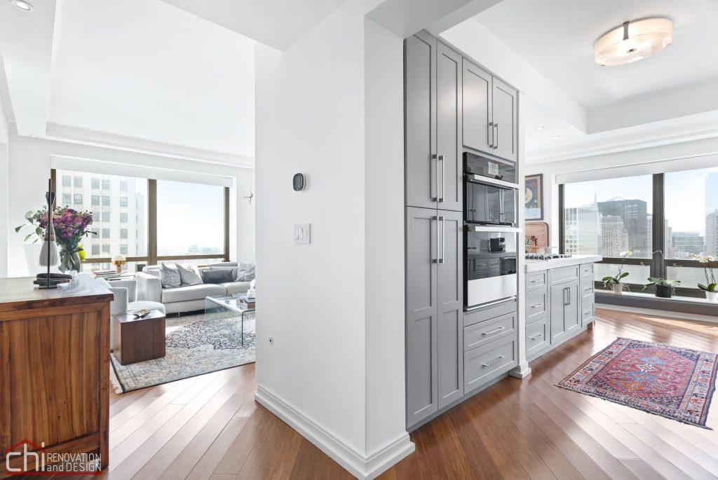 Chi | Chicago Condo Remodel Sleek Living Room Entrance
